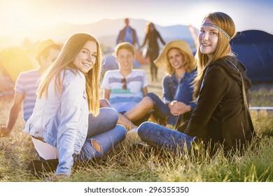 Group of beautiful teens camping at summer festival