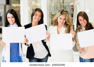 Group of beautiful women holding banner ads