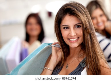 Group of beautiful women shopping and holding bags