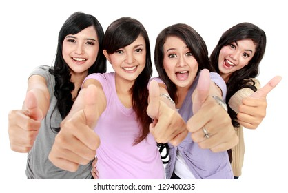 Group of beautiful women showing thumbs up together to camera