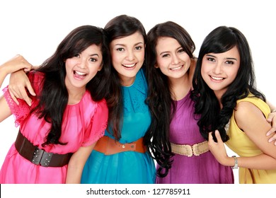 Group of beautiful women smiling wearing colorful dress together isolated over white background