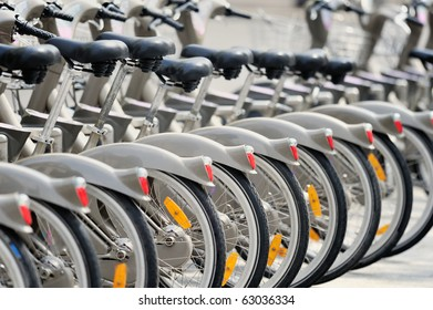 Group of bicycles in the row.  Photo with tilt-shift lens