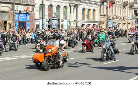 "The group of bikers on motorcycles. St. Petersburg, Russia - 9 May, 2016. Holiday-action ""Immortal regiment"" taking place in St. Petersburg on Nevsky Prospect."