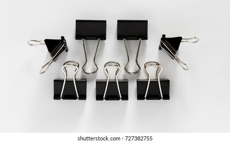 A group of black binder clips isolated on white background