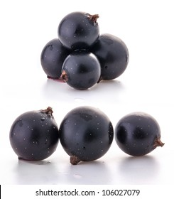 Group of black currant isolated on white background.