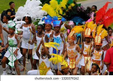 Group of black girls in white jumping up at the Junior Caribana Parage Toronto, Ontario, Canada - July 19, 2008