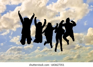 Group of black silhouettes people  jumping against cloudy blue sky background