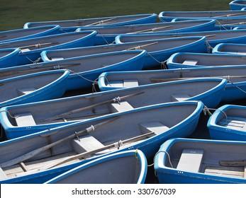 group of blue rowboat at river