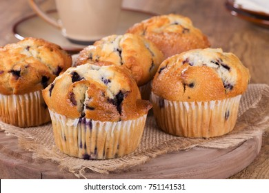 Group of blueberry muffins on a wooden platter