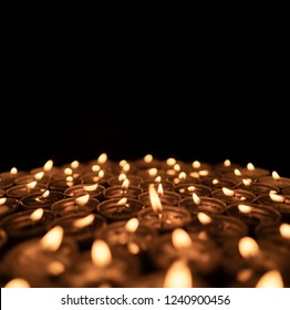 Group of blurred candles isolated on black background