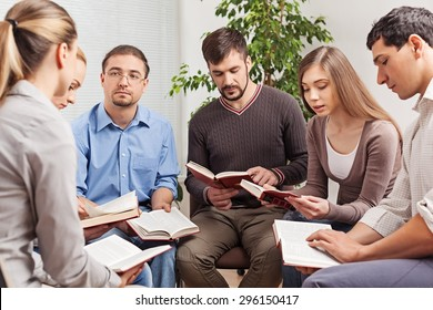Group, book, studying.
