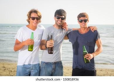 Group of Boys Cheering at Beach