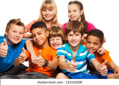 Group of boys and girls Caucasian and black showing thumb up