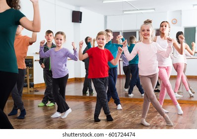 group of boys and girls studying contemp dance in studio