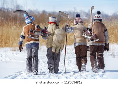 Group of boys go hockey on a local lake in winter