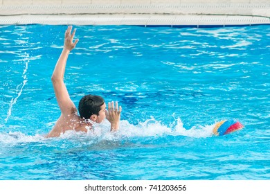 Group of boys playing water polo during competitions