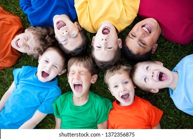 Group of Boys Yelling in Grass Outside