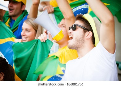 Group of brazilian supporters at stadium - Stock Image