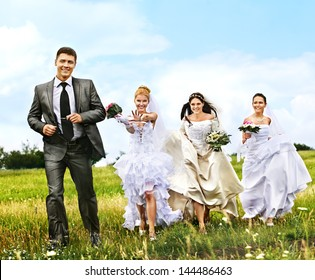 Group bride and groom wedding summer outdoor.