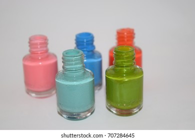 Group of bright nail polishes isolated on white. Set of Color Nail Polish.