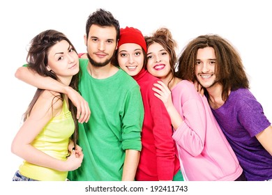 Group of bright young people standing together. Isolated over white.