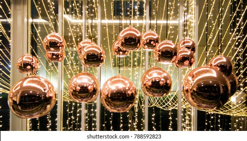 Group of bubble copper lamps hanging on ceil and decorated by line of little warm white electricity light look so beautiful and luxury.