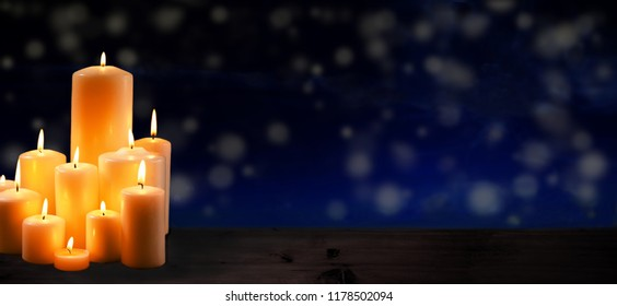 group of burning candles to commemorate