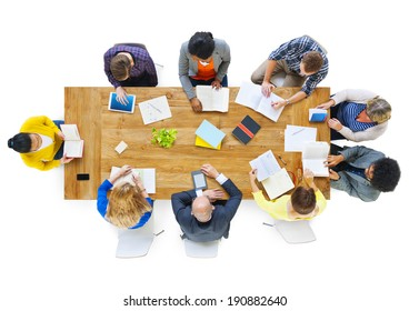 Group of Busienss People Reading Notes on a Meeting Table