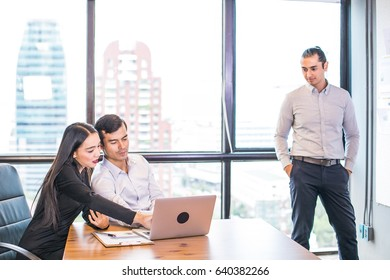 Group of business colleagues in team casual discussion, startup project business meeting teamwork brainstorm concept, with copy space.Asian Business People Meeting Corporate Laptop Technology Concept.