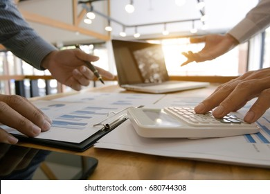 group of Business executives analysis data document and calculating about fee tax at a office