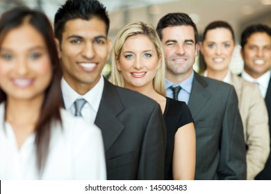 group of business executives standing in a row