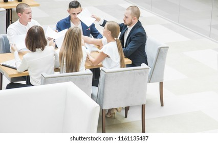 Group of business meeting at the table in the modern office ,Team work and diverse hands together joining business relationships with greetings and joint business partnership.