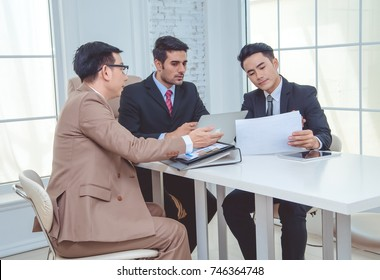 Group of business partners analyzing and discussing during a working meeting in a modern office, business concept.