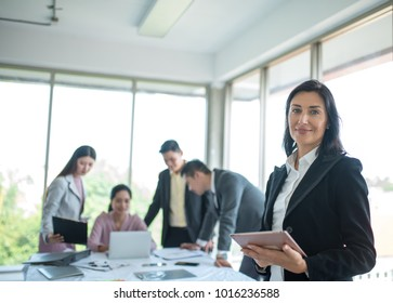 A group of business partners during a set team meeting in the modern office of an office building.