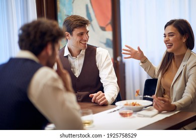 A group of business partners having a good time at a lunch in a relaxed atmosphere at the restaurant. Business, restaurant, lunch