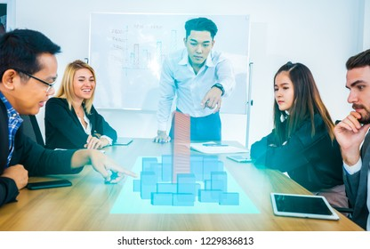 Group of business partners meeting present with modern buildings hologram. Real estate business and building technology concepts.