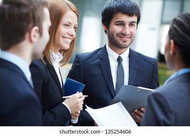 Group of business partners negotiating