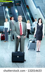 Group of business people in airport. Travel background.