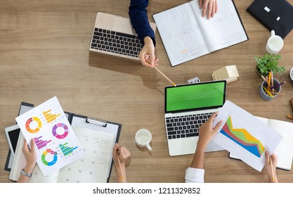 group of business people analyzes or Statistics financial options on wooden office desk. Top view of business team and manager in a meeting brainstorming together. start business plan concept
