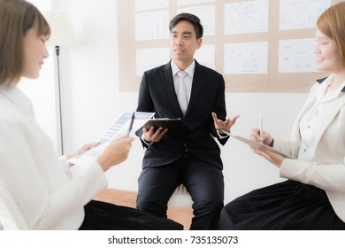 Group of business people busy discussing financial matter during meeting. Asian people
