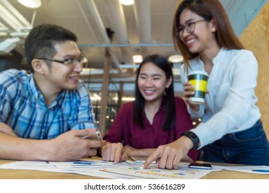 Group Of Business people with casual suit Meeting In the modern coffee shop, closeup at finger, business group concept