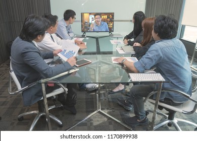 Group of business people in casual wear  meeting Having Video Conference In Boardroom
