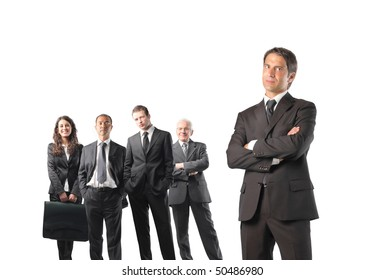 Group of business people with close up to a serious businessman