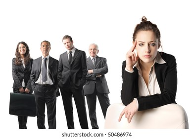 Group of business people and close up to a young businesswoman