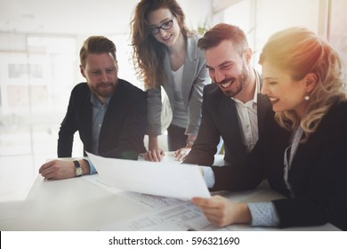 Group of business people collaborating on project  in office