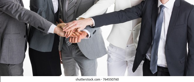 Group of business people crossed arms in pile for win. Stack of hands. Cooperation concept