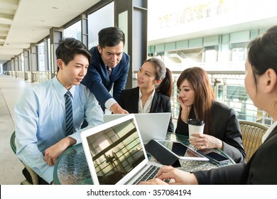 Group of business people discuss about the contract
