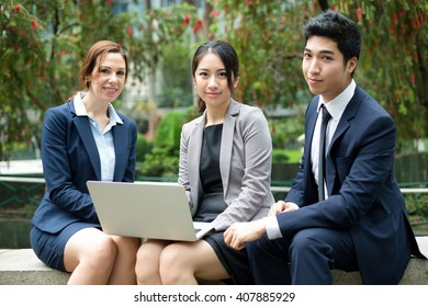 Group of Business people discuss on laptop computer