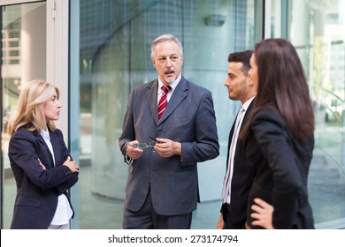 Group of business people discussing about something