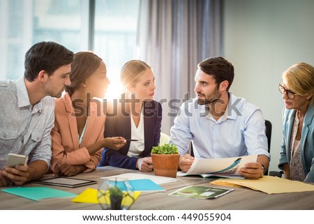 Group of business people discussing at desk in the office